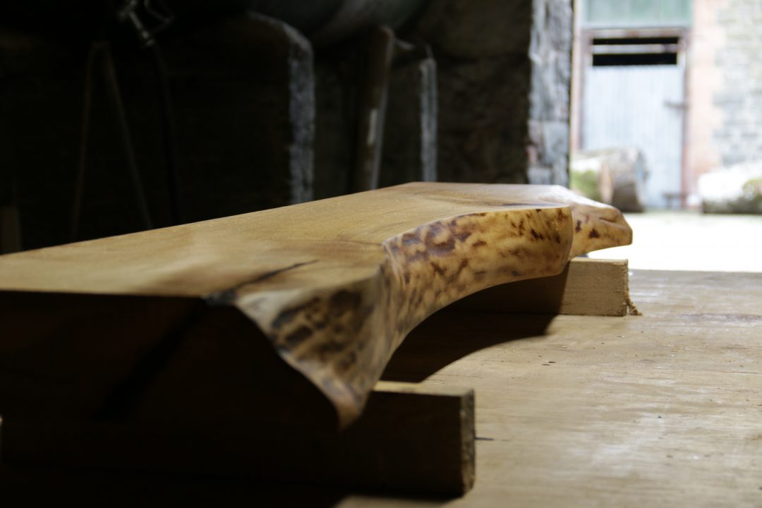 wooden live edge sculpting mantles